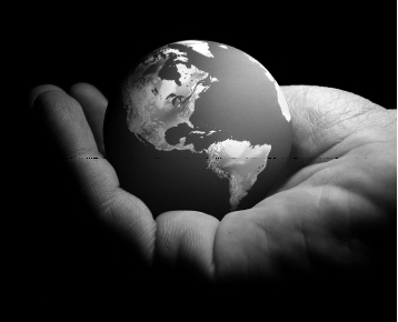 Black and white photo of a hand holding the world