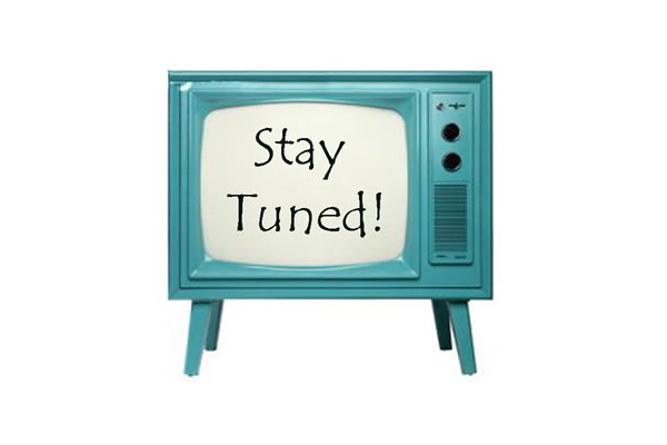 stay tuned text on tv screen